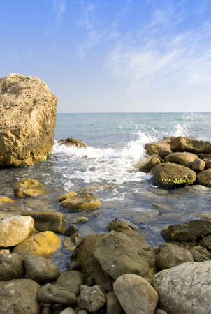 crag: Sea coast with stones in the foreground Stock Photo