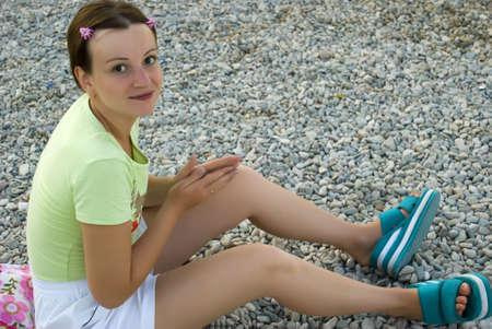 The young girl on a beach. A beach ������ a pebble photo