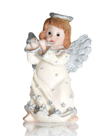 godlike: Toy - an angel playing on a flute.