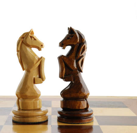 two chess horse. Figures of a chess are cut out from a tree - manual work