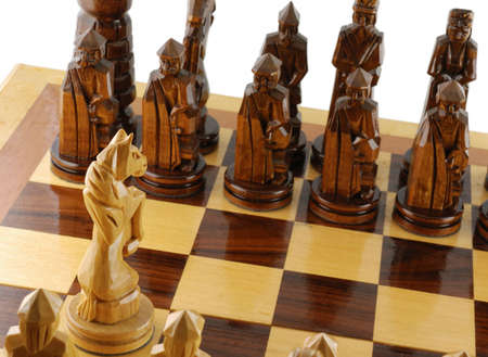 maneuvering: attack a chess horse. Figures of a chess are cut out from a tree - manual work