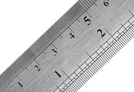 depth measurement: A fragment of a metal ruler with a textural covering
