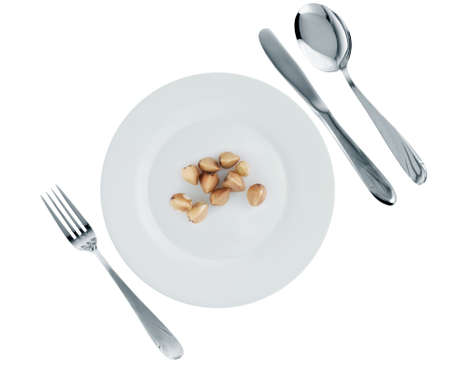 Vegetarian dish -buckwheat. A crude product of the big size on an empty plate photo