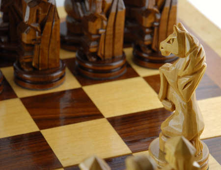 maneuvering: go a chess horse. Figures of a chess are cut out from a tree - manual work Stock Photo