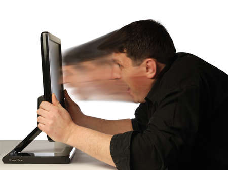 Computer dependence. Abstract tightenings of the person in the monitor Stock Photo - 2572344