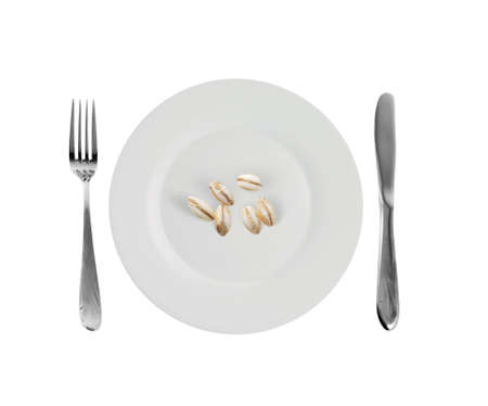 Vegetarian dish - pearl-barley. A crude product of the big size on an empty plate Stock Photo - 2572319