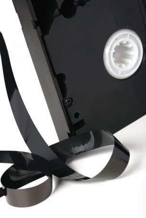 videocassette: Videocassette. El obsoleto cassete que est� aislado sobre un fondo blanco Foto de archivo