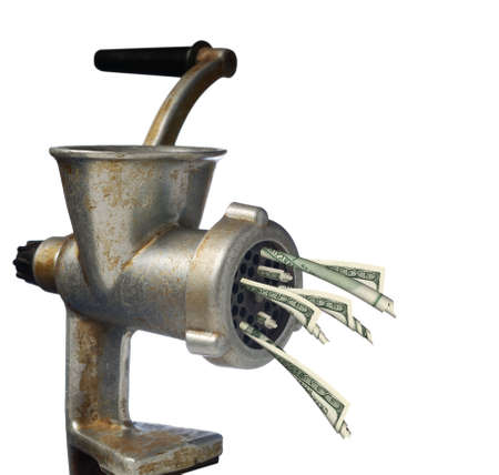Euro and dollars. Transformation dollars on an old meat grinder photo