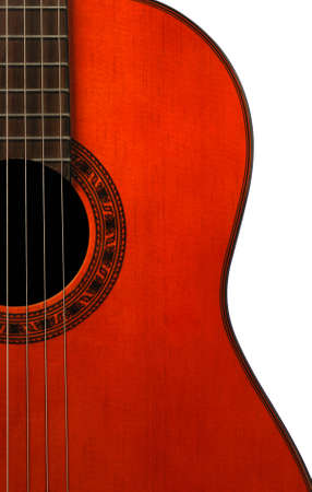 Acoustic six-string guitar. Covered by a brown varnish