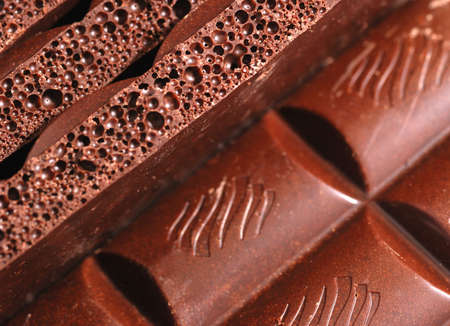 Chocolate. The broken tile of porous black chocolate photo