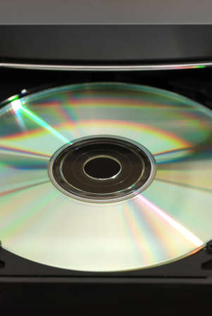 medium closeup: Disk in the  drive. A photo close up CD of a disk Stock Photo