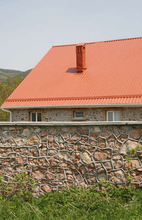 Red roof. A cottage constructed highly in mountains photo