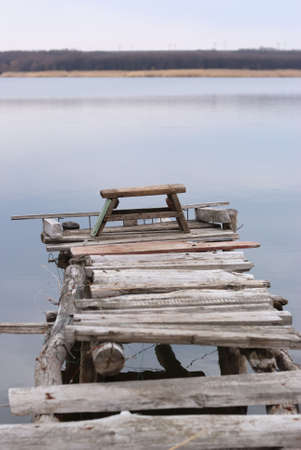 singleness: Fishing place. The approach on a wooden flooring to a place of fishing Stock Photo