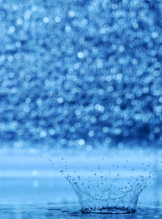 splash and blur bacground. A water table with effective drops stains on water Stock Photo - 3294297