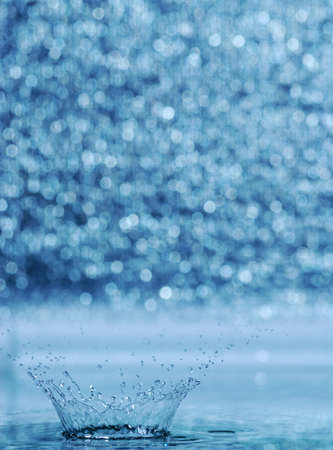 splash and blur bacground. A water table with effective drops stains on water Stock Photo - 3379551