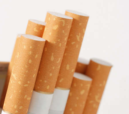 Cigarettes. The open pack of cigarettes with the yellow filter Stock Photo