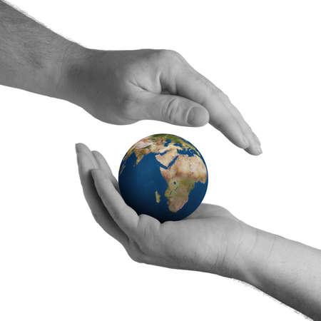El planeta tierra en manos humanas. Concepto sobre la preservaci�n del medio ambiente  Foto de archivo - 3379613