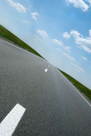 Asphalt road. A transport highway with the blue sky. A transport highway with the blue sky photo