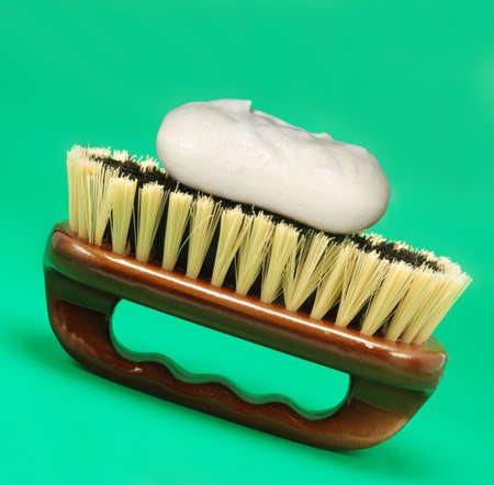 Brush for cleaning. The wooden handle, a natural bristle Stock Photo - 3440492