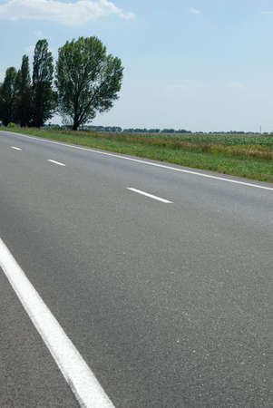 Asphalt road. A transport highway with the blue sky. A transport highway with the blue sky Stock Photo - 3531141