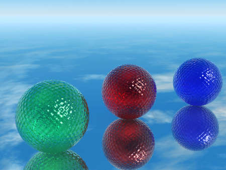 ridge: Color glass spheres. Three color glass spheres with a ridge structure on a smooth surface