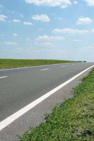 Asphalt road. A transport highway with the blue sky. A transport highway with the blue sky Stock Photo - 3563778