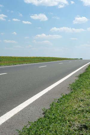 Asphalt road. A transport highway with the blue sky. A transport highway with the blue sky Stock Photo - 3563778