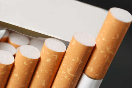 vices: Cigarettes. The open pack of cigarettes with the yellow filter Stock Photo