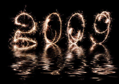 Inscription - 2009 made by celebratory fireworks. Reflection in water celebratory fireworks 2009 photo