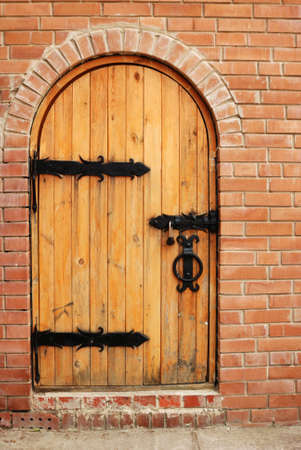 Wooden doors with lock and brick Stock Photo - 3590161