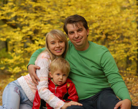 Family. Mum, the daddy, the son in autumn forest. Effective blur a background Stock Photo - 3677336