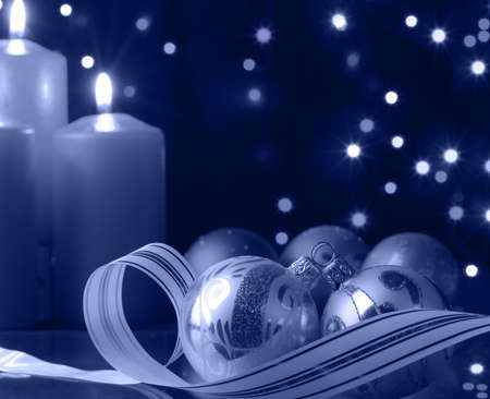 Christmas evening. A composition from candles, New Years toys on a dark background photo