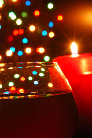 Glass of wine. On a background of celebratory fires, illumination by candles photo