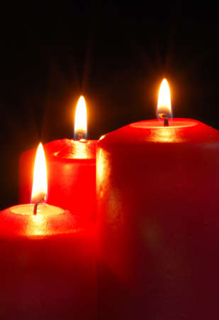 Candle. A burning flame of a candle of red color photo