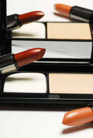 lipstick and powder  box. A subject for care of a leather of the person. A female toilet accessory Stock Photo - 3948988