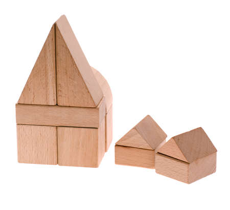 Toy houses. Wooden cubes combined in the form of constructions Stock Photo - 4037186