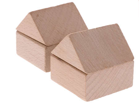 Toy houses. Wooden cubes combined in the form of constructions Stock Photo - 4037184