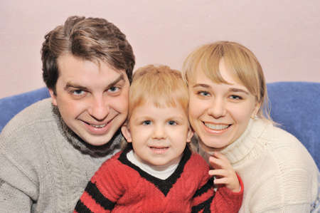 expressing: Happy family. Family from three person in house conditions