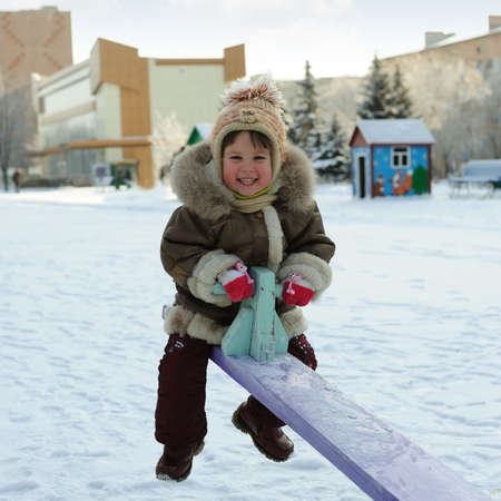 The girl on a swing. Winter, solar frosty weather Stock Photo - 4167710