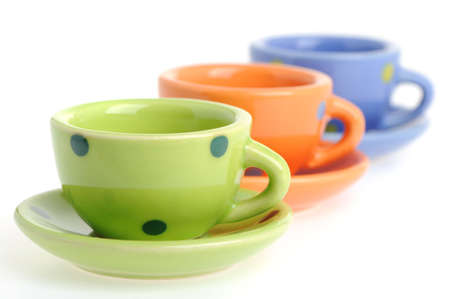 Color cups. Tiny utensils it is isolated on a white background