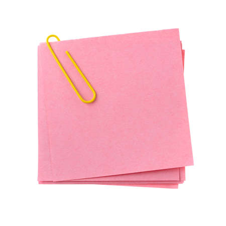 Red paper note with yellow clinch. It is attached red pin on a white background Stock Photo - 4233281