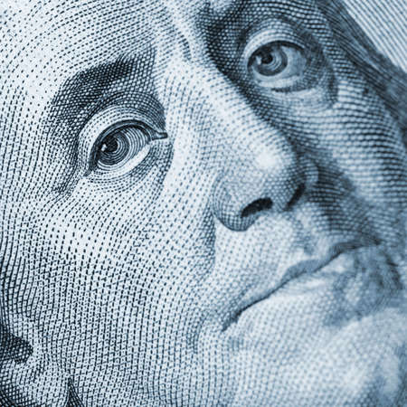 Franklin portrait closeup blue color. A fragment of a photo hundred dollar denominations