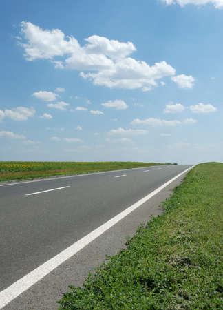 Asphalt road. A transport highway with the blue sky. A transport highway with the blue sky Stock Photo - 4263322