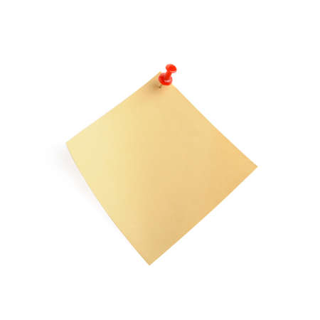 yellow paper note with shadow. It is attached red pin on a white background photo