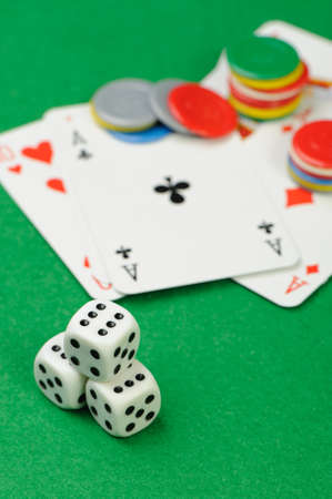 dices and playing cards. Game cubes and Playing cards on a green background  photo