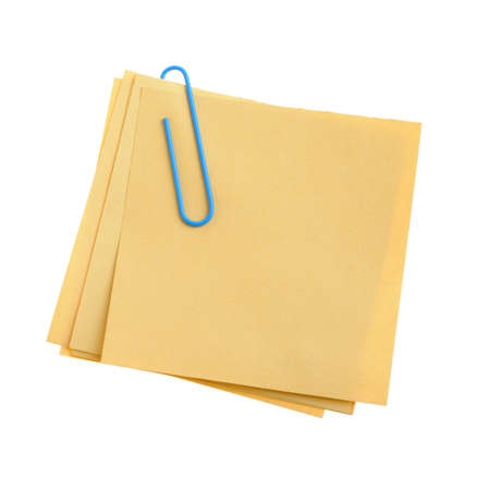 Paper note with green clinch. It is attached red pin on a white background photo