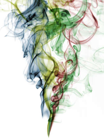 abstract color smoke from white background . The abstract image of a smoke on a white background photo