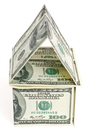 Dollar - the house. An abstract design from dollars in the form of dwelling photo