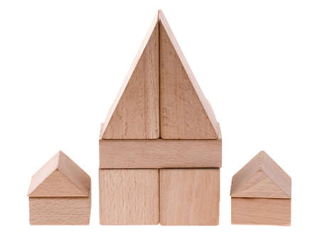 Toy houses. Wooden cubes combined in the form of constructions photo