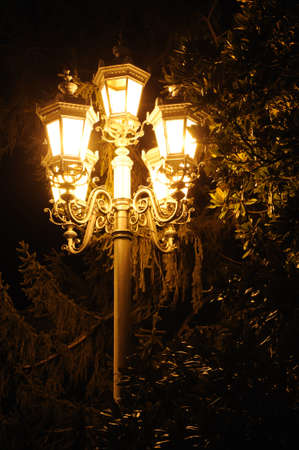 unearthly: Ancient lantern. A night photo, light from street lanterns
